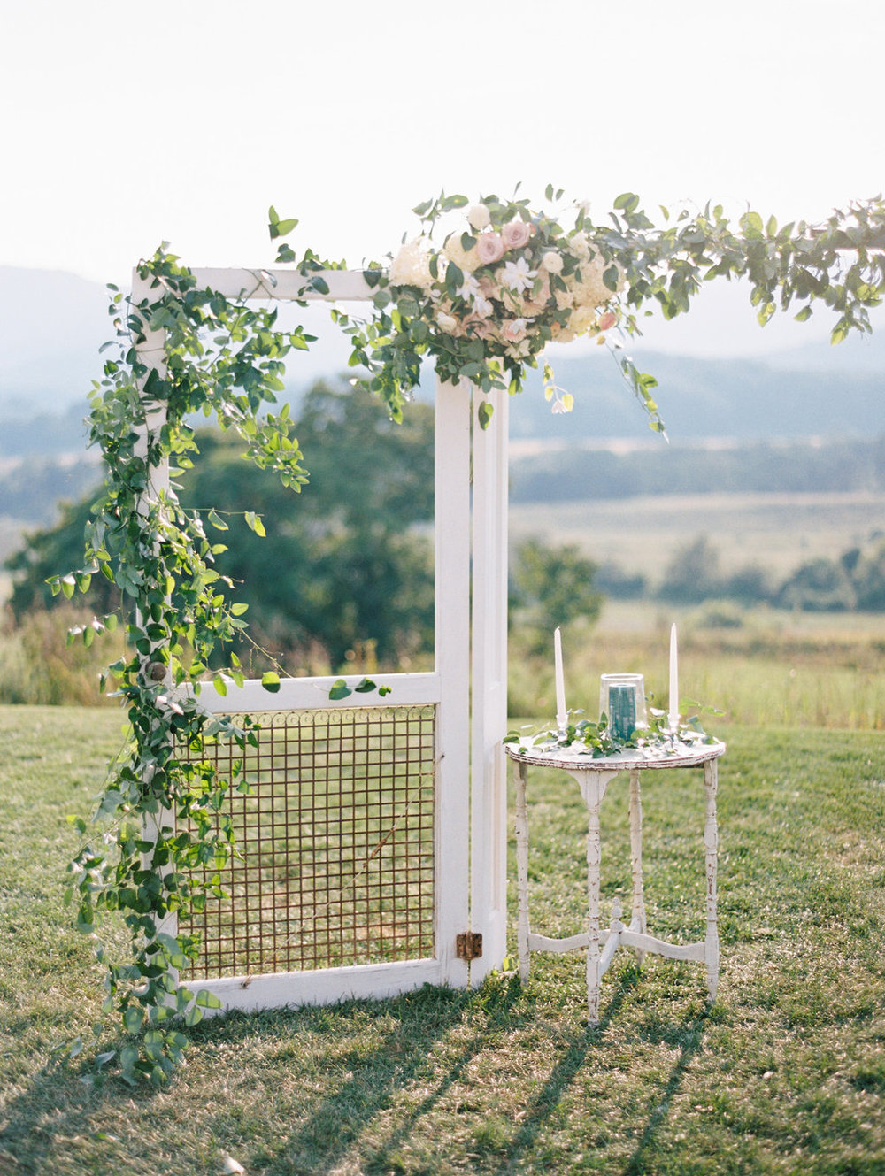 Southern Vintage doors arbor and white table