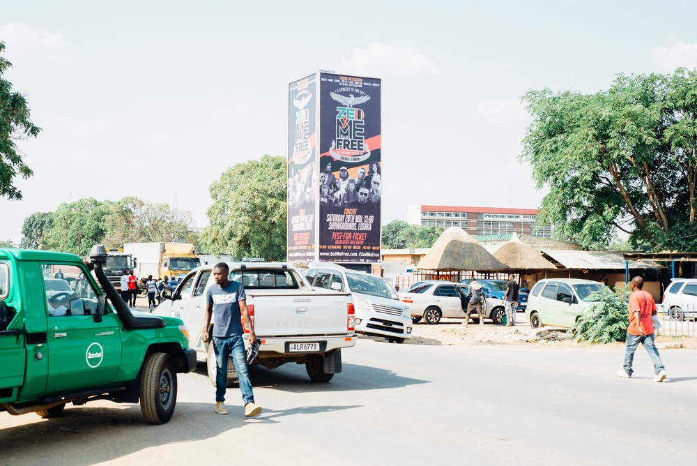 A vertical billboard deployed near the central bus station in Lusaka, the capital city of Zambia.