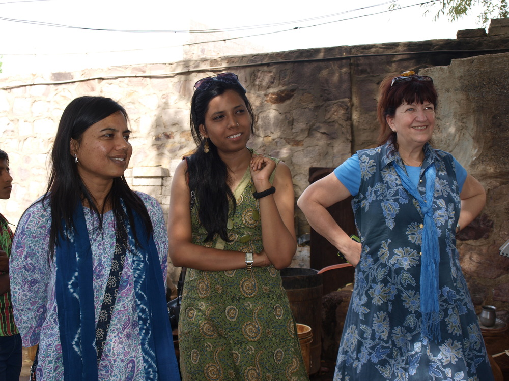 Pictured is Rashmi Dhariwal, founder and CEO of SETU, Riya Sharma, designer and Lorelei VerLee, Ex. Dir. CWOW at an artisan site in India.