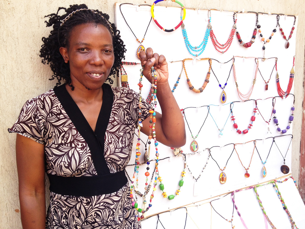 One of our new artisans from Kampala, Uganda displaying her beautiful jewelry creations.