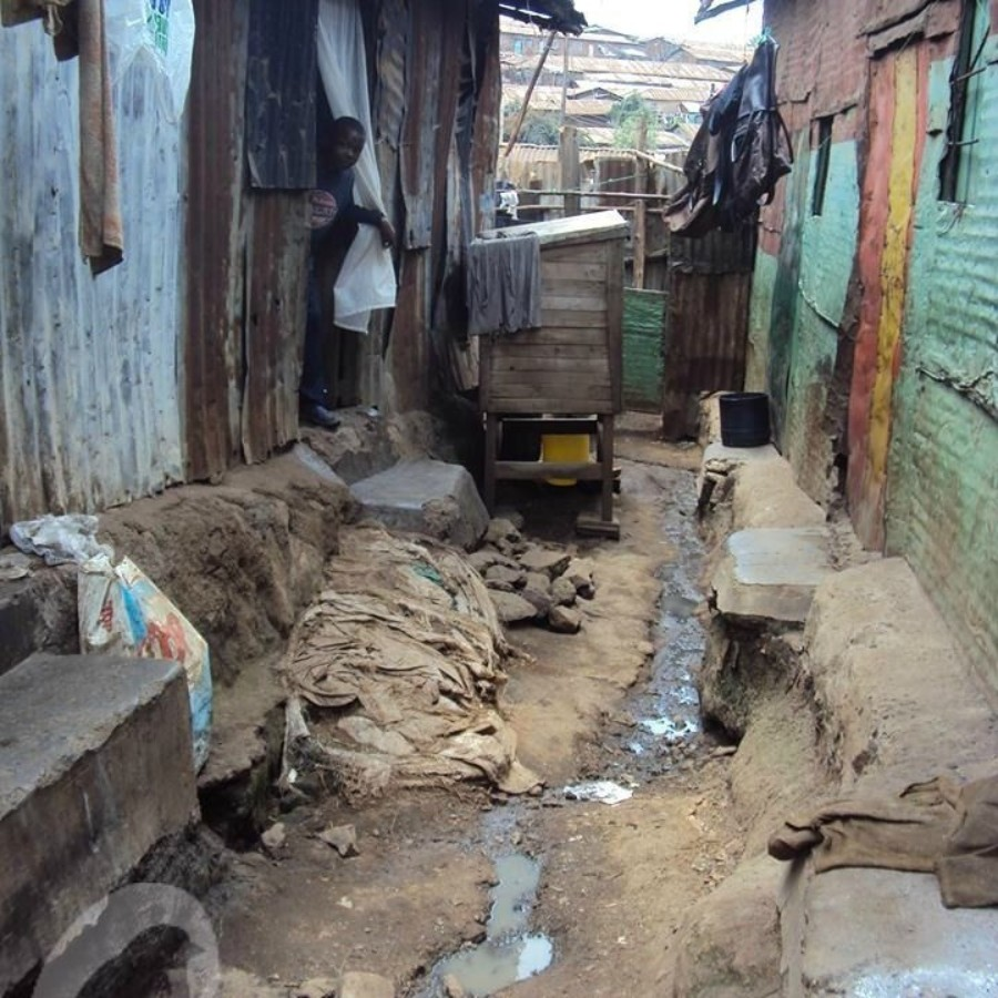 - Without regard for her own tidy appearance, she walks through dirty, rocky paths lined with mud houses and lovingly seeks out women who are struggling to feed their families.