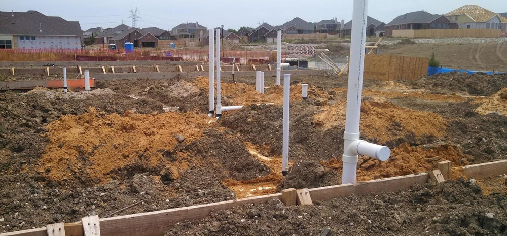 Plumbing before slab poured