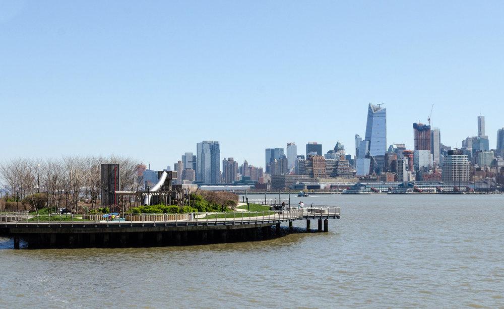 Pier C in Hoboken and Manhattan behind.