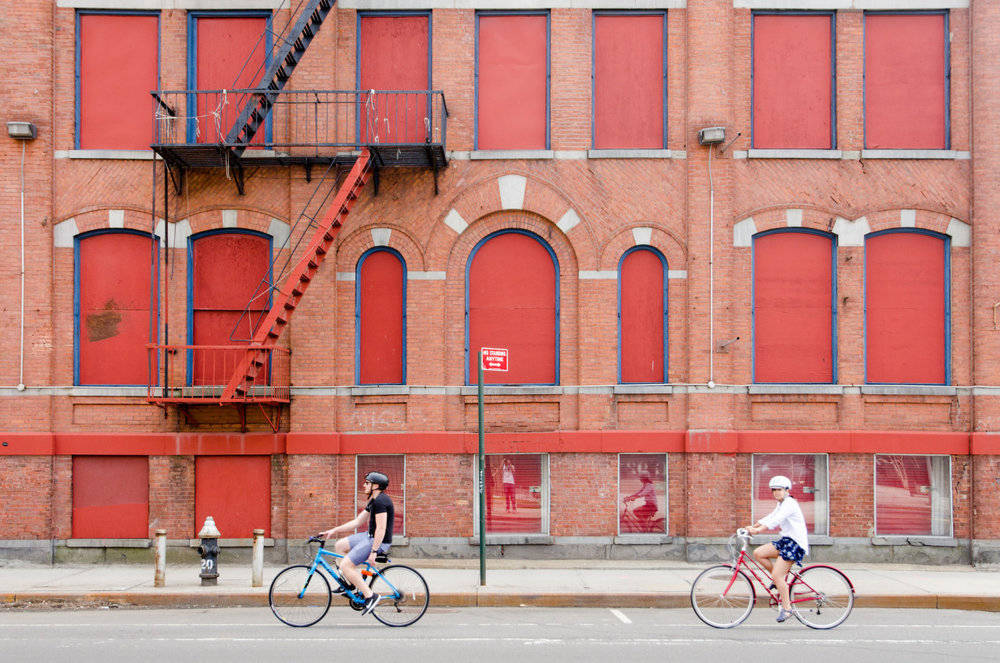 Bicyclists on Flushing Avenue in Fort Greene, Brooklyn, NY