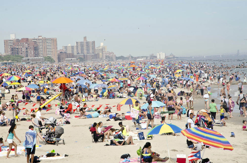 Umbrellas of Coney Island on a Sunday in June.