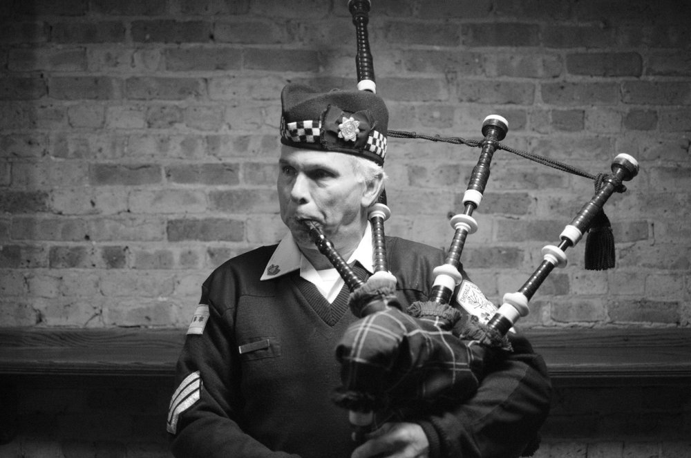 Bagpiper plays at a bar in downtown Chicago following my brother's rehearsal dinner, 2013.