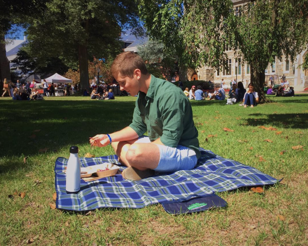 Enjoy your food on the lawn with one of our blankets - Stop by our table (by the large tree in Red Square) to rent one for free!
