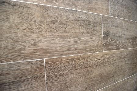 Wood replica tiles in master bath offer texture and durability of design