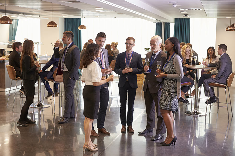 delegates-networking-at-conference-drinks-PWTVTW9.jpg
