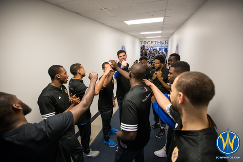 59bdbe66 Santa Cruz Warriors players gather before going out to the court at Kaiser  Permanente Arena on March 24, 2016 (Photo: Ariel Nava Photography)