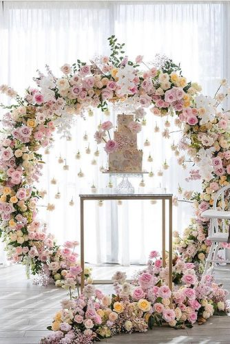 wedding-trends-2019-elegant-cake-table-with-hanging-pare-pink-white-orchid-flower-arch-georgejohnphotography-334x500.jpg