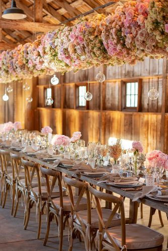 wedding-trends-2019-long-table-in-barn-with-suspended-flowers-and-glass-decor-eddiezaratsian-334x500.jpg