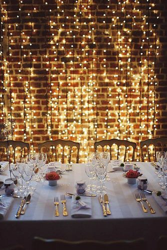 wedding-trends-2019-bridal-light-bulbs-arrangement-on-brick-loft-wall-elegant-reception-with-red-roses-cathy-dudzinski-photography-334x500.jpg