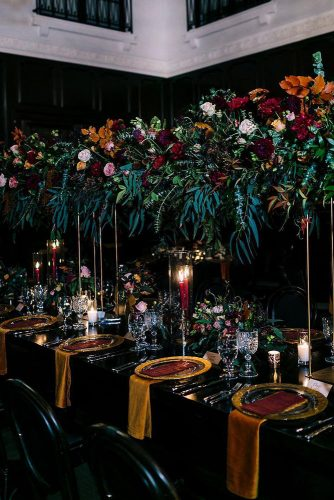 wedding-trends-2019-dark-mood-bridal-table-fall-colors-tall-orange-burgundy-greenery-flower-centerpieces-candles-camrynclairphoto-334x500.jpg