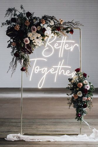 wedding-trends-2019-minimalistic-arch-dark-moody-flowers-and-neon-romantic-sign-littlepineappleneon-334x500.jpg