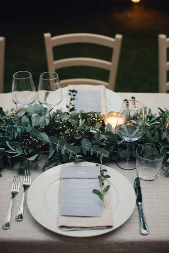 wedding-trends-2019-white-burlap-tablecloth-and-greenery-eucalyptus-table-runner-with-candles-duepunti-wedding-photography-334x500.jpg