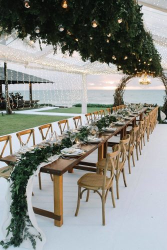 wedding-trends-2019-long-chic-rustic-table-with-greenery-and-gold-geometry-centerpieces-on-the-beach-axioo-334x500.jpg
