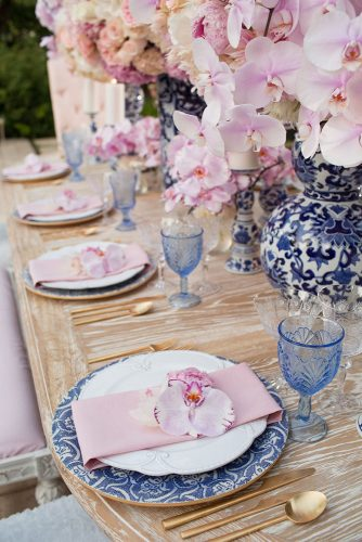 wedding-trends-2019-bridal-table-pink-orchids-eclectic-white-blue-vaces-and-glasses-duke-images-334x500.jpg
