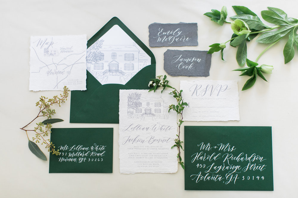 Beautiful wedding invitation suite that features a sketch of Vinewood Plantation, spot calligraphy, and a map of Newnan, GA. The envelope liner is the perfect final touch for this suite; just one more element that will wow your guests! Photo by Alexis June.