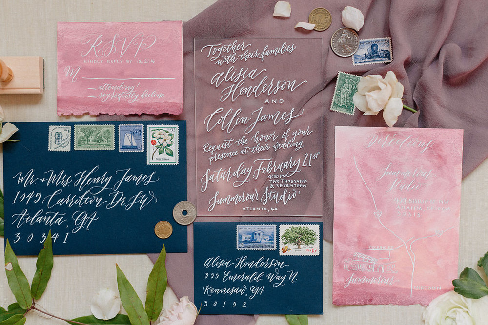 This stunning suite features a mauve calligraphy wash, white calligraphy, and an acrylic invitations! (Just FYI, acrylic invitations are extremely expensive to mass-produce. This photo is being used to mainly represent design aesthetic as well as calligraphy style.) Photo by Michelle Scott.