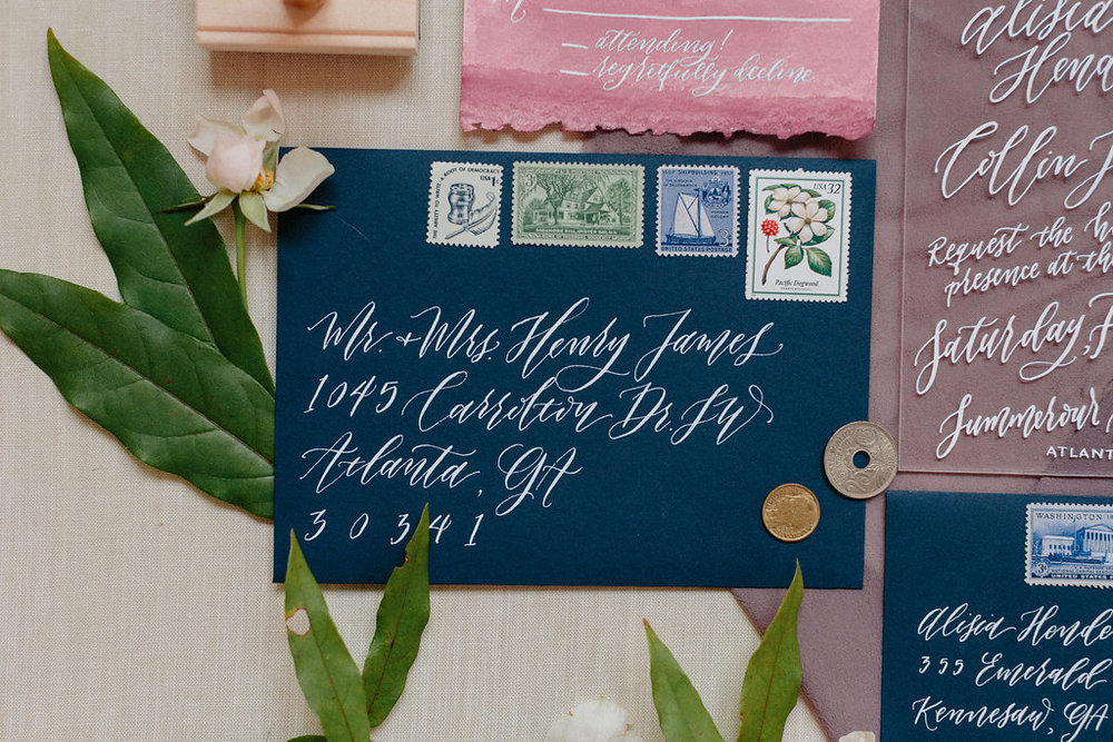 Vintage postage adds an additional special touch to your wedding invitations! ElisaAnne Calligraphy offers a package that includes vintage postage if that is an invitation feature that interests you. We would love to talk about vintage postage with you more! Photo by Michelle Scott.