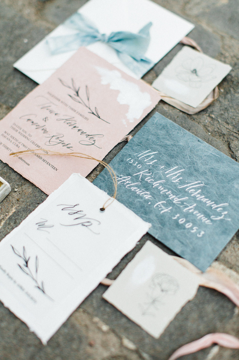 This minimalist wedding invitation suite features simplistic design elements and whimsical calligraphy. If you desire, we have the ability to print on handmade paper for your invitation suite! The suite itself will be more expensive if this technique is used, but it is a beautiful way to showcase your wedding invitations. Photo by Natalie Jackson.