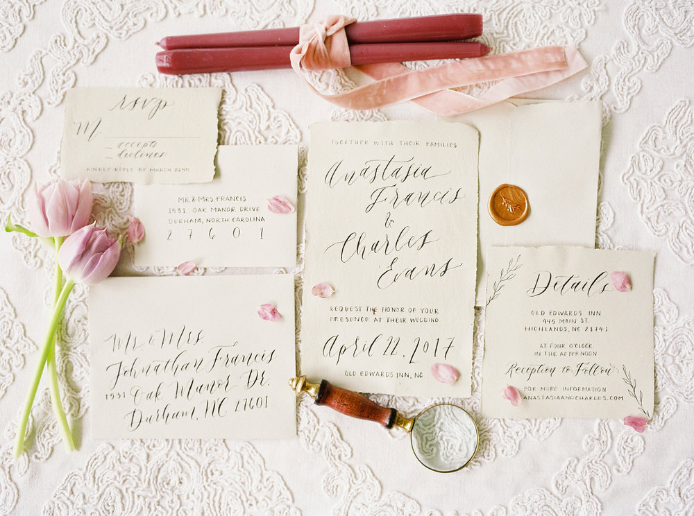 This suite features a simplistic copper wax seal; wax seals on invitation suites have recently seen a surge in popularity! Though they require a little bit of additional postage, they are often worth the cost, as they provide a timeless and elegant touch to any invitation suite. Photo by Noi Tran.