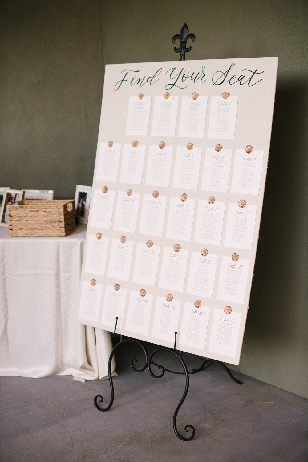 This linen seating chart for a wedding at the Atlanta Athletic Club featured more than 300 names, with calligraphy on each card for the table numbers. Photo by    Carrie Joy Photography   .