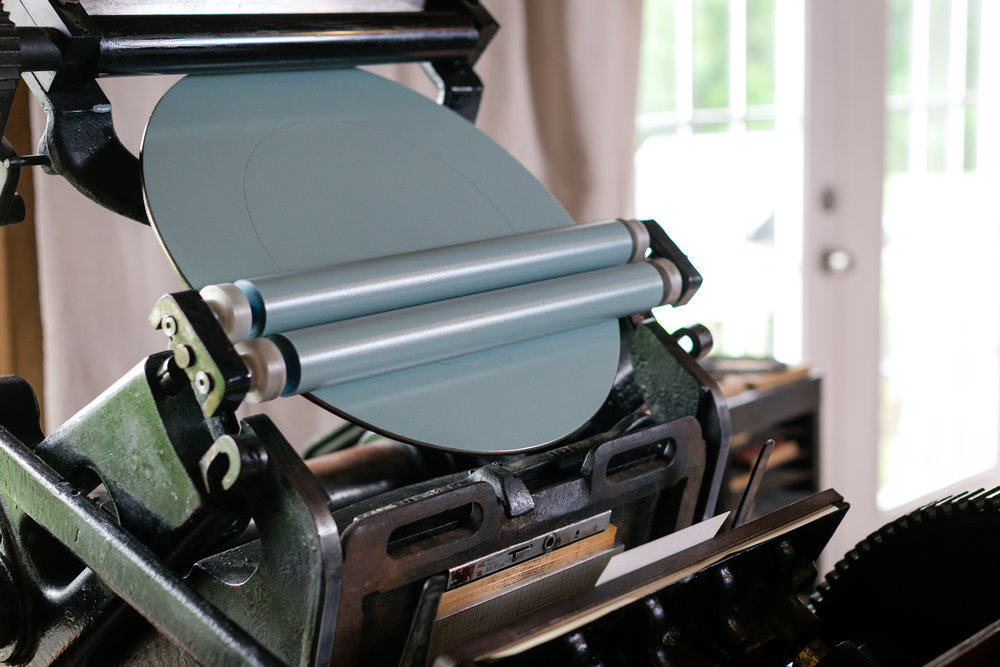 As you can see, there is only one color loaded onto the rollers and the ink plate! This color will be used to stamp ONE manufactured plate with a design on it.  LOVE KNOT PHOTO.
