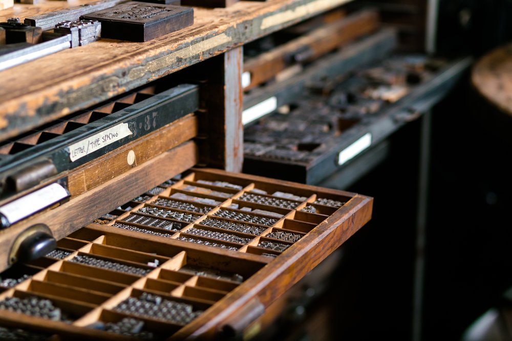 This is a beautiful example of how individual letterpress letters have to be stored. Before plates could be manufactured with plastic, the individual letters had to be organized on the letterpress to create your desired message.  LOVE KNOT PHOTO.