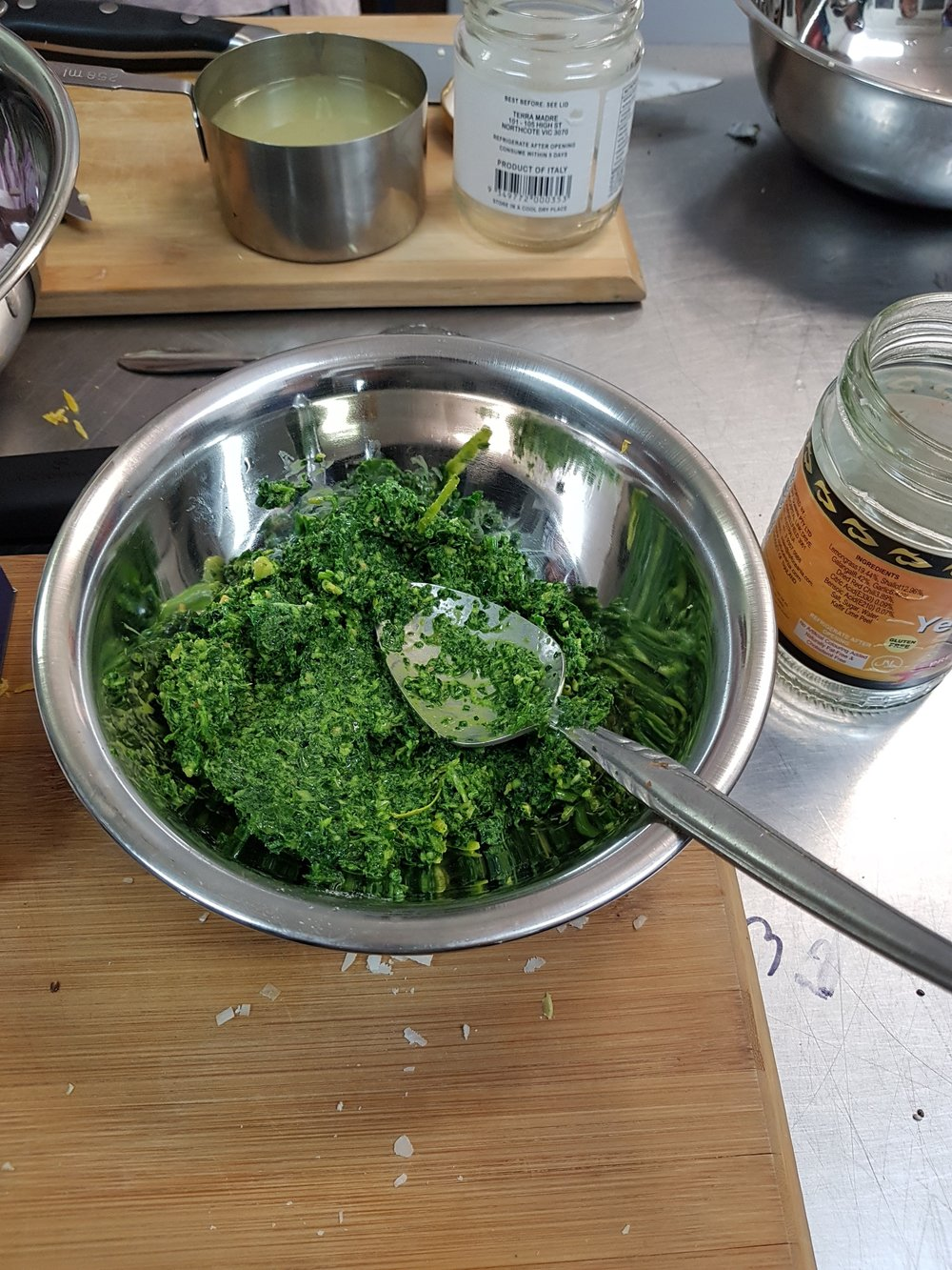 A mixing bowl filled with the finished kale pesto.