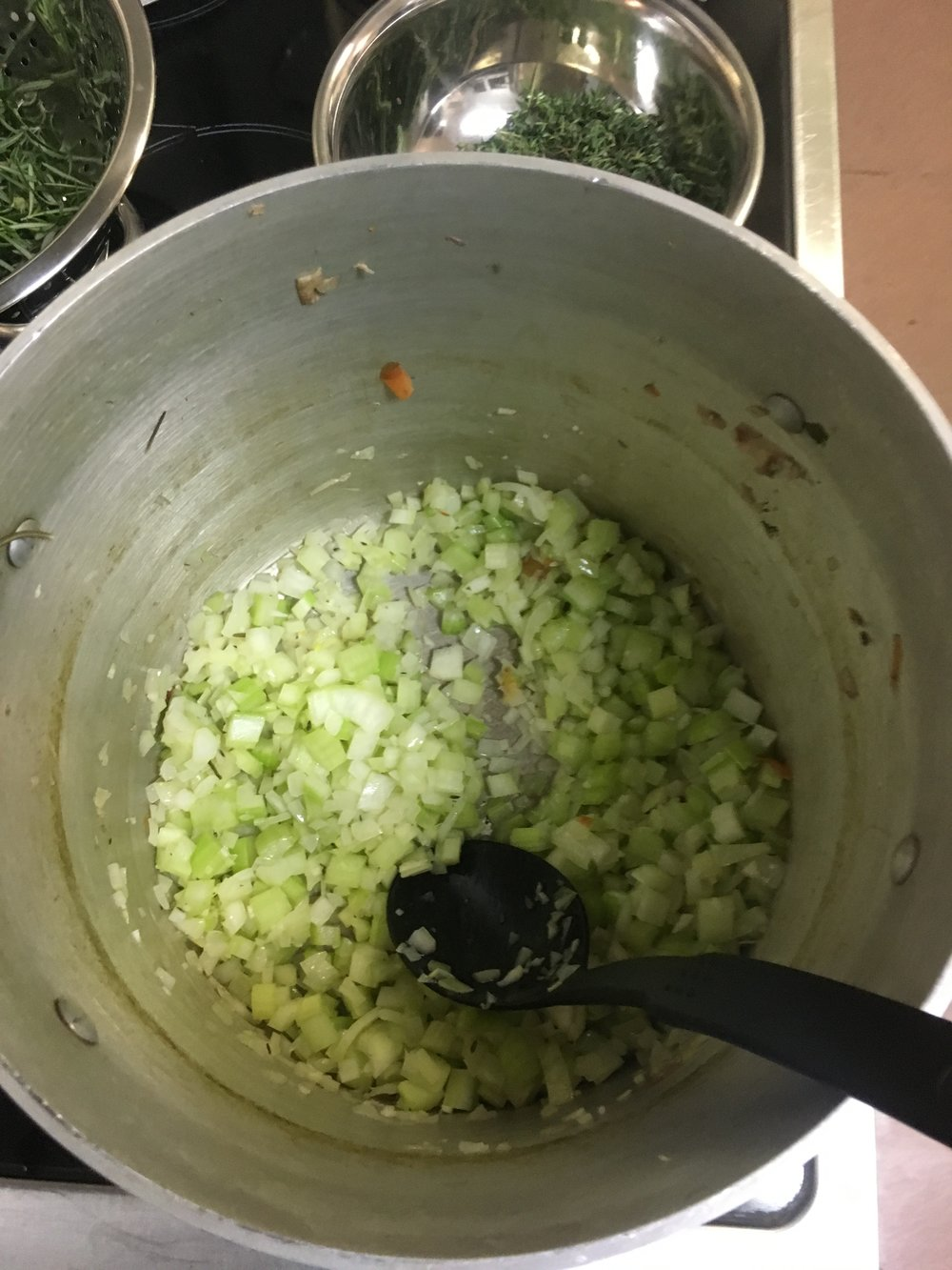 Onions, garlic and celery frying to become the base of the soup.
