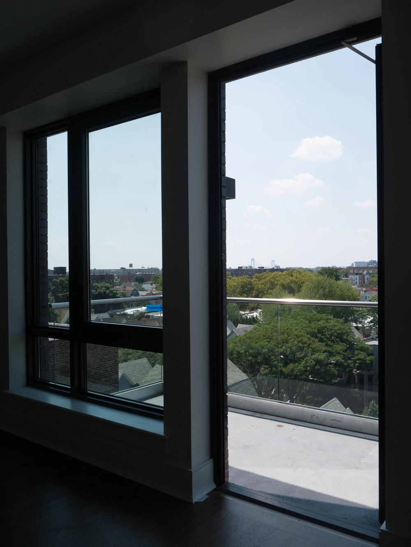 11 8a master bedroom balcony through br window.jpg