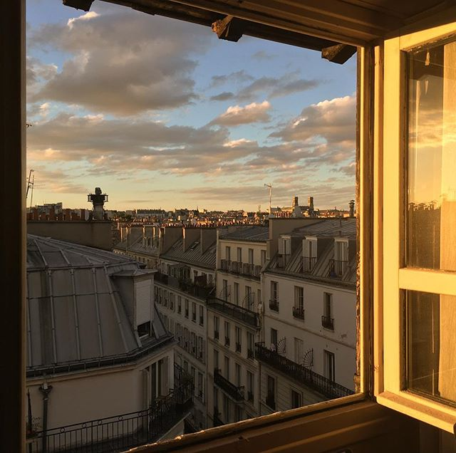 The lovely #view from the hallway across from our top floor room at the @mercureparisoperagarnier #paris #sunset #lucky711
