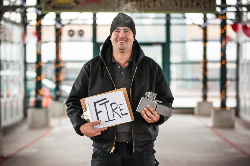 Man holding a sign saying fire.