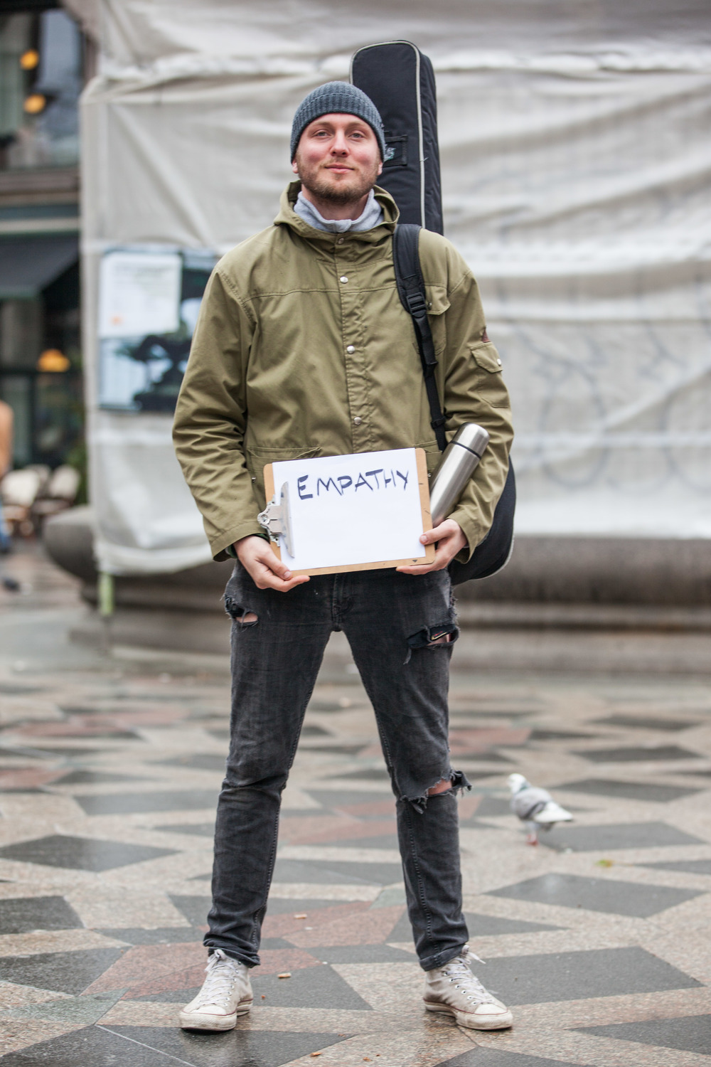 Man holding a sign that says empathy.