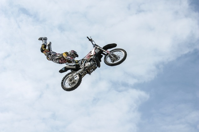 Man flying in the air with his motorcylce.