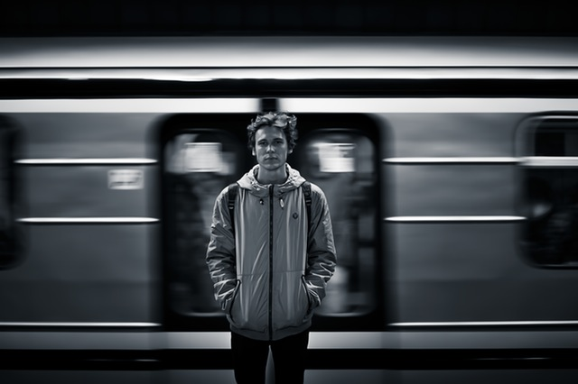 Man standing in front of train.
