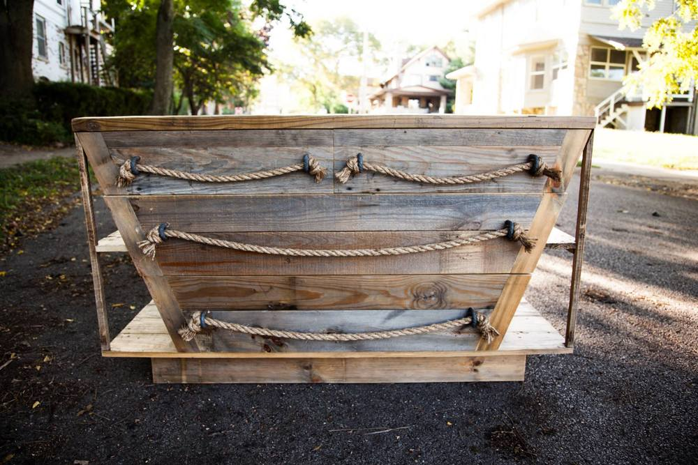 Nautical dresser made out of reclaimed wood.