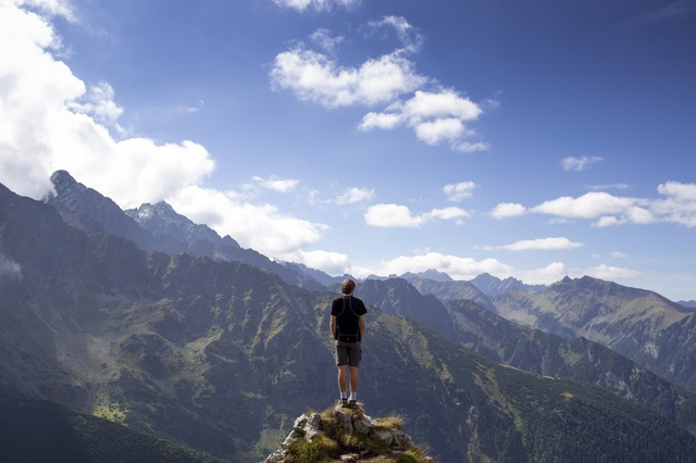 Man standing on a mountain top.