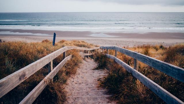Beach view with boardwalk.