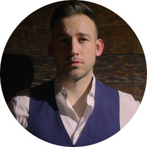 Masculine man wearing a vest.