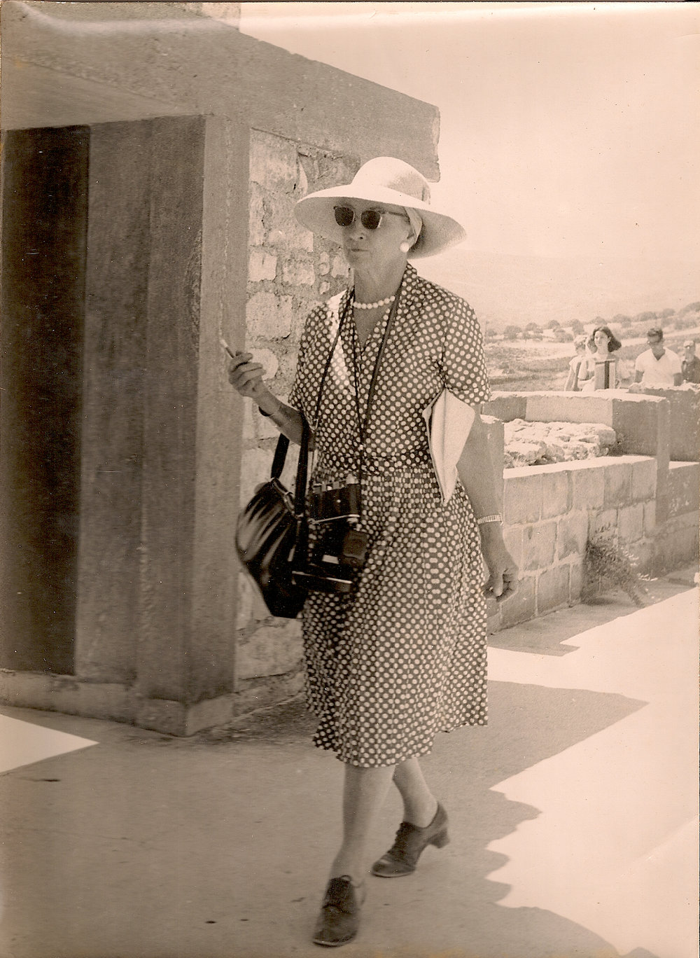 A world traveler late in life - Ann Riley exploring antiquity in Greece.