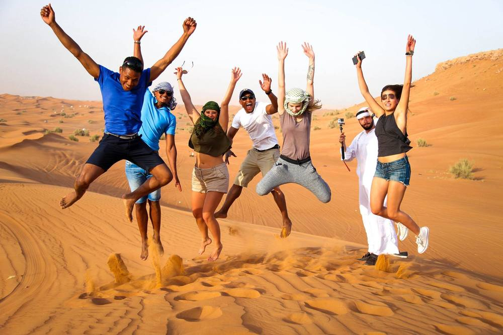 friends on the desert in dubai