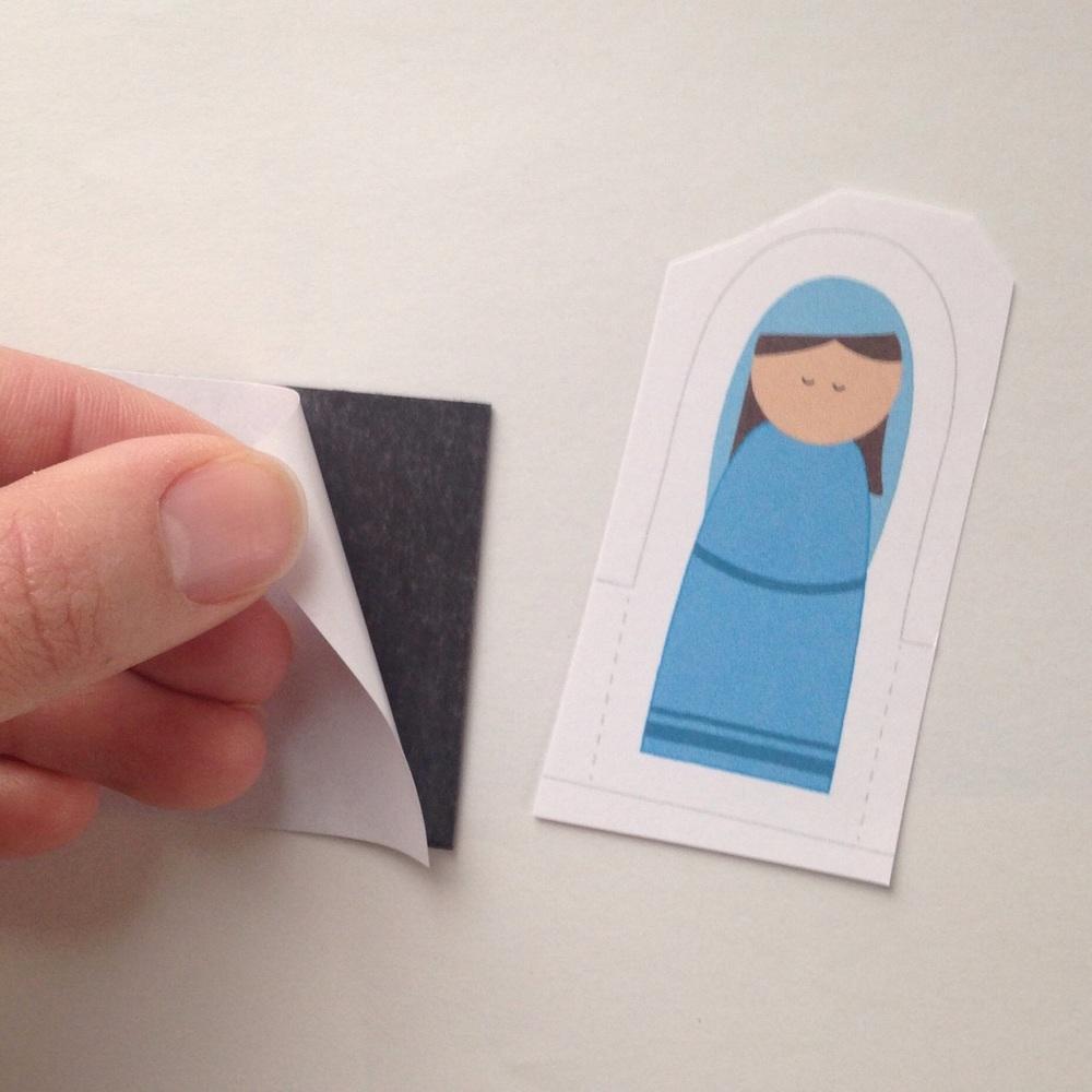Peel backing off magnet.