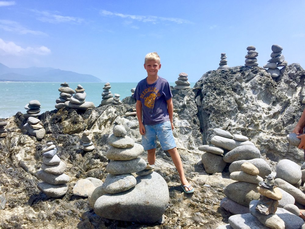 This is me standing with some piles of rocks called cairns, we built some.