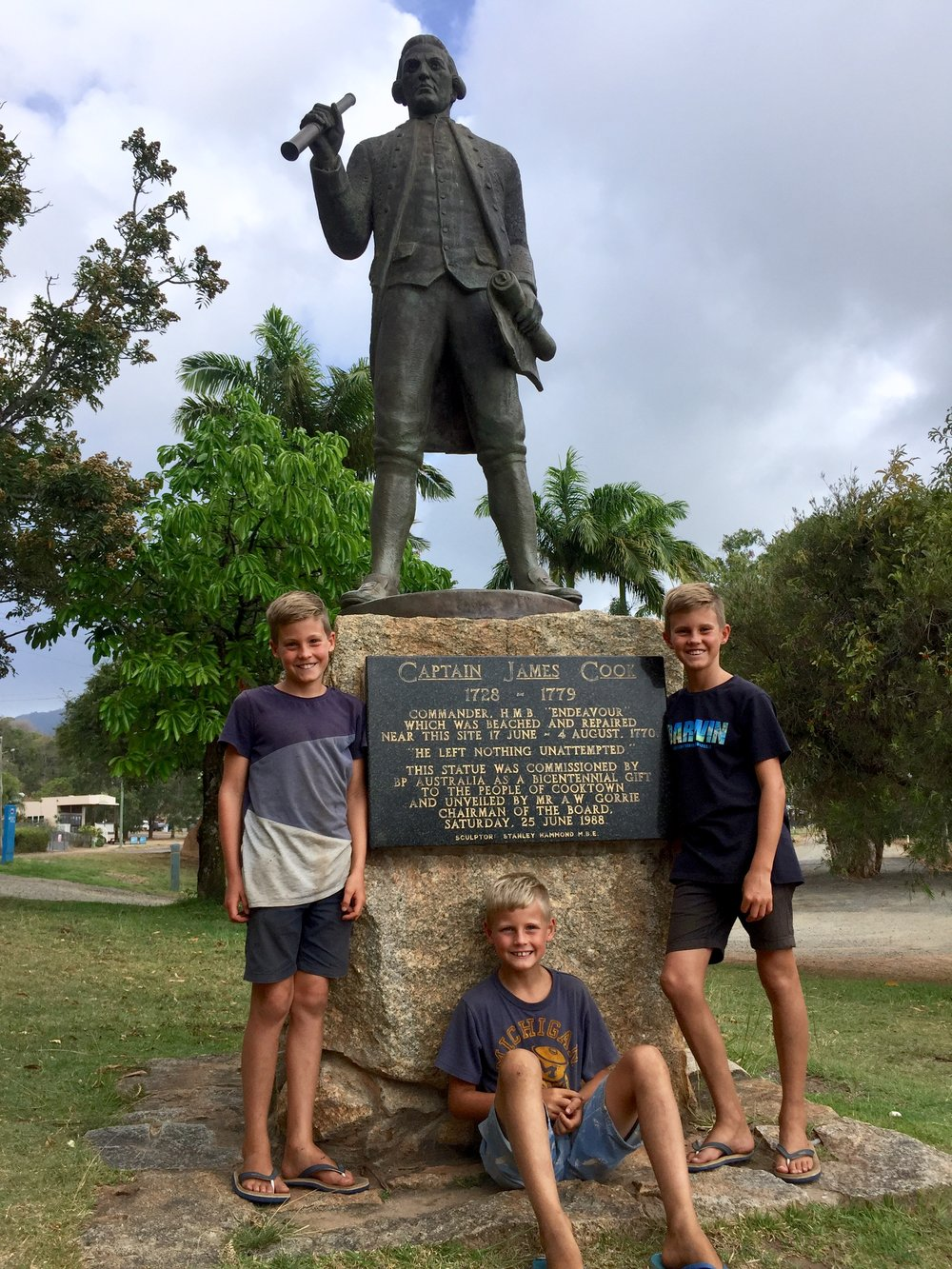 This is my brothers and me standing with a statue of Captain Cook.