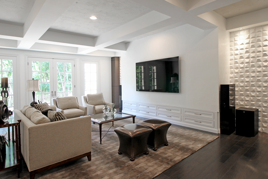 Because this basement family room is so large, coffered beams were added, which broke up and gave depth to the ceiling. The space also features a built-in entertainment zone.