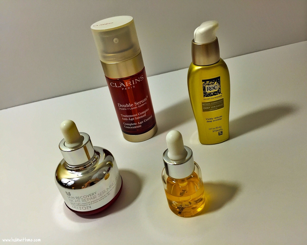 Anti-aging serums from Clarins, ROC, LeeJiHam, and Mizon.