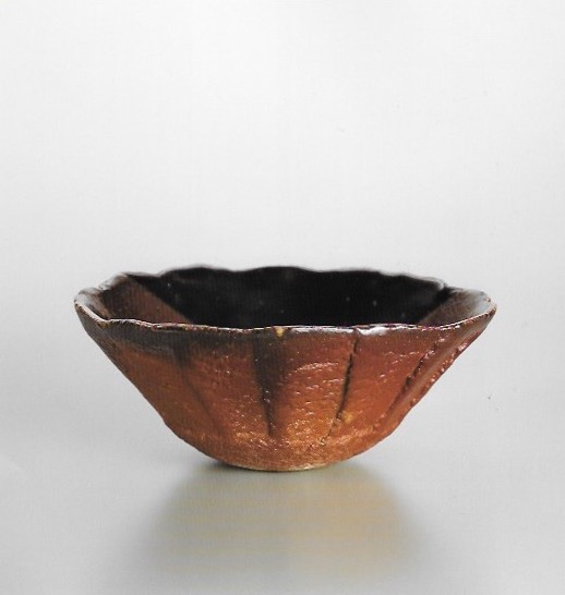 Fluted bowl in Nishihata's own deep red akadobe glaze. Nishihata was able to revive this ancient Tamba glaze, for which the methods to create it had long been lost, after 30 years of experimentation.